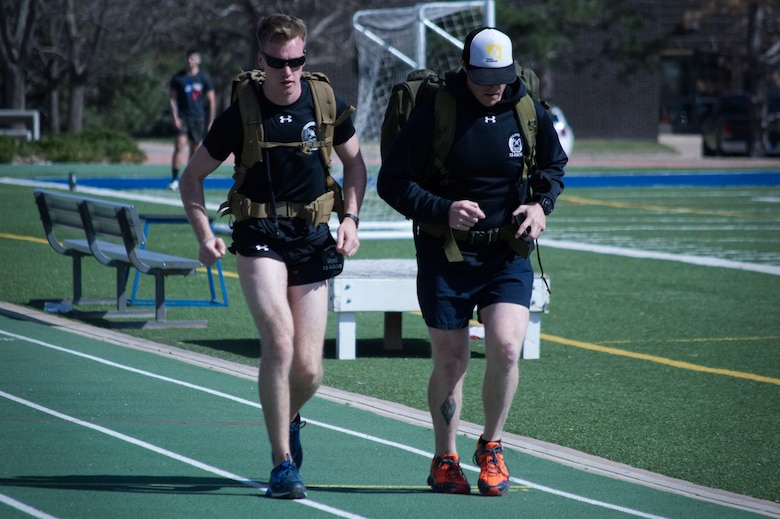 Airmen from the 13th Air Support Operations Squadron completed the 24-hour run challenge in honor of 12 fallen servicemembers at Peterson Air Force Base, Colo., Fitness Center track,