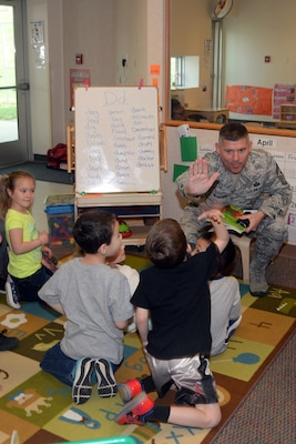 U.S. Air Force Chief Master Sgt. Patrick McMahon, senior enlisted leader of U.S. Strategic Command (USSTRATCOM), shares a high five as he reads to children at Child Development Center (CDC) I on Offutt Air Force Base, Neb., April 26, 2018. McMahon and other USSTRATCOM senior leaders read to children at the CDC in honor of Month of the Military Child, designated in April as a time to honor the sacrifices of the more than 1.7 million children of military members serving globally.