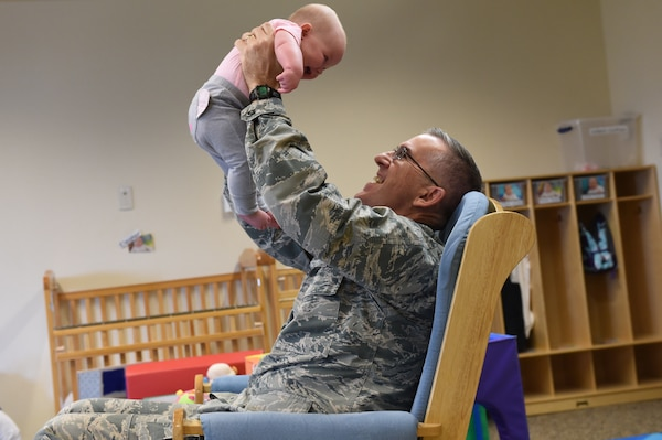 U.S. Air Force Gen. John Hyten, commander of U.S. Strategic Command (USSTRATCOM), plays with a 3-month-old baby during a visit to Child Development Center (CDC) II at Offutt Air Force Base, Neb., April 26, 2018. Hyten and other USSTRATCOM senior leaders read to children at the CDC in honor of Month of the Military Child, designated in April as a time to honor the sacrifices of the more than 1.7 million children of military members serving globally.