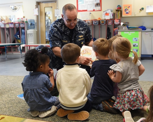 U.S. Navy Vice Adm. Charles Richard, deputy commander of U.S. Strategic Command (USSTRATCOM), reads to children during a visit to Child Development Center (CDC) II at Offutt Air Force Base, Neb., April 26, 2018. Richard and other USSTRATCOM senior leaders read to children at the CDC in honor of Month of the Military Child, designated in April as a time to honor the sacrifices of the more than 1.7 million children of military members serving globally.