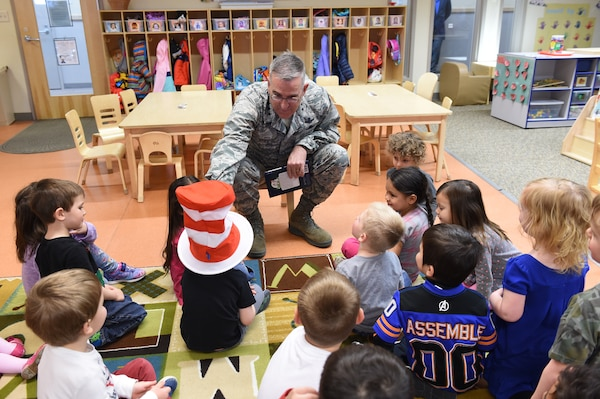 U.S. Air Force Gen. John Hyten, commander of U.S. Strategic Command (USSTRATCOM), shares the Cat in the Hat reading hat before he reads to children at the Child Development Center (CDC) II at Offutt Air Force Base, Neb., April 26, 2018. Hyten and other USSTRATCOM senior leaders read to children at the CDC in honor of Month of the Military Child, designated in April as a time to honor the sacrifices of the more than 1.7 million children of military members serving globally.