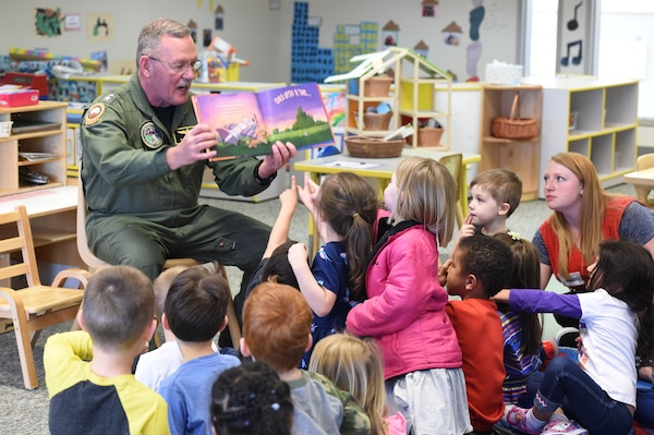 U.S. Navy Rear Admiral Daniel H. Fillion, director of U.S. Strategic Command (USSTRATCOM) Global Operations, reads to children during a visit to Child Development Center (CDC) II at Offutt Air Force Base, Neb., April 26, 2018. Fillion and other USSTRATCOM senior leaders read to children at the CDC in honor of Month of the Military Child, designated in April as a time to honor the sacrifices of the more than 1.7 million children of military members serving globally.