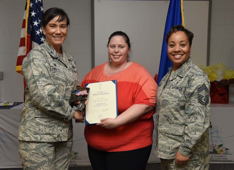 U.S. Air Force Col. Debra Lovette, 81st Training Wing commander, and Chief Master Sgt. Tanya Johnson, 81st Diagnostic and Therapeutics Squadron superintendent, presents Teressa Vieira, spouse of Jon Vieira, 81st Logistics Readiness Squadron motor vehicle operator, with a Volunteer Excellence certificate during the 2018 Volunteer Appreciation Ceremony at the Sablich Center at Keesler Air Force Base, Mississippi, April 26, 2018. The event recognized Keesler personnel, family members and retirees for their volunteer service in 2017. (U.S. Air Force photo by Kemberly Groue)