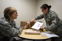Col. Jennifer Short, left, 23d Wing commander, and Senior Airman Evelyn Alvarado, 23d Aerospace Medicine Squadron public health technician, perform an inspection on a meal, ready-to-eat, April 30, 2018, at Moody Air Force Base, Ga.  Short toured the 23d Medical Group (MDG) to gain a better understanding of their overall mission, capabilities, and comprehensive duties, and was able to experience the day-to-day operations of the various units within the 23d MDG, ranging from bioenvironmental to ambulatory care. (U.S. Air Force photo by Airman 1st Class Eugene Oliver)