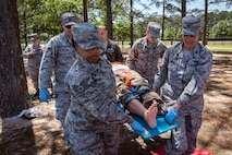 Col. Jennifer Short, right, 23d Wing commander, along with Airmen from the 23d Medical Group (MDG), carry a mannequin, April 30, 2018, at Moody Air Force Base, Ga. Short toured the 23d MDG to gain a better understanding of their overall mission, capabilities, and comprehensive duties, and was able to experience the day-to-day operations of the various units within the 23d MDG, ranging from bioenvironmental to ambulatory care. (U.S. Air Force photo by Airman 1st Class Eugene Oliver)
