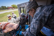 Col. Jennifer Short, right, 23d Wing commander, prepares to receive a gurney holding a mannequin, April 30, 2018, at Moody Air Force Base, Ga. Short toured the 23d Medical Group (MDG) to gain a better understanding of their overall mission, capabilities, and comprehensive duties, and was able to experience the day-to-day operations of the various units within the 23d MDG, ranging from bioenvironmental to ambulatory care. (U.S. Air Force photo by Airman 1st Class Eugene Oliver)
