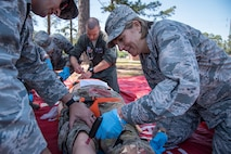 Col. Jennifer Short, right, 23d Wing commander, creates an intravenous incision into the leg of a mannequin, April 30, 2018, at Moody Air Force Base, Ga. Short toured the 23d Medical Group (MDG) to gain a better understanding of their overall mission, capabilities, and comprehensive duties, and was able to experience the day-to-day operations of the various units within the 23d MDG, ranging from bioenvironmental to ambulatory care. (U.S. Air Force photo by Airman 1st Class Eugene Oliver)