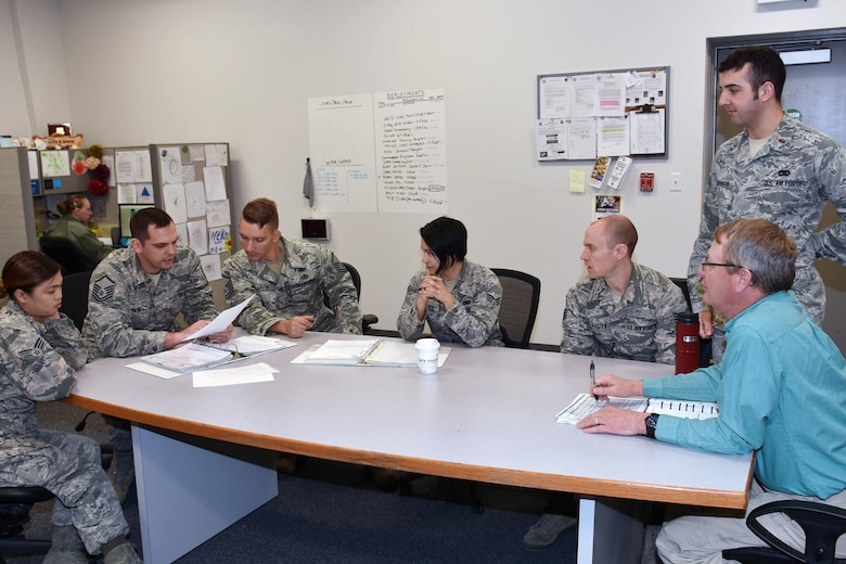 During a recent meeting, 131st and 509th Logistic Readiness Squadron members discuss mission planning goals. Capitalizing on the strengths of the active duty and the Air National Guard keeps the total force team competitive for honors such as the recent Maj Gen. Warren R. Carter Logistics Effectiveness Award.  (U.S. Air National Guard photo by Senior Master Sgt. Mary-Dale Amison)