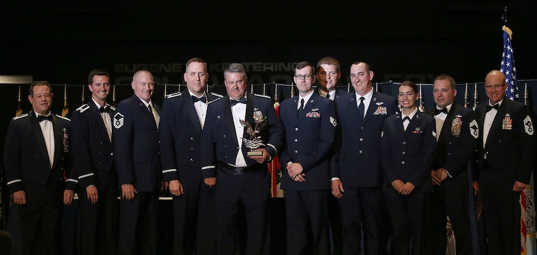 Members of the 89th Airlift Squadron accept the 445th Airlift Wing 2017 Squadron of the Year Award from Col. Adam Willis, 445th Airlift Wing commander, and Chief Master Sgt. Paul Stewart, 445 AW command chief, during the wing's annual awards banquet held April 7, 2018 at the National Museum of the U.S. Air Force