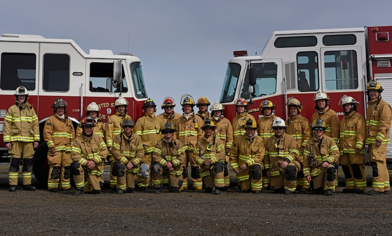 Oregon Air National Guard Airmen from Kingsley Field and civil engineer officers from multiple locations across the U.S. pose for a photo after a structural live fire exercise at Fairchild Air Force Base, Washington, April 18, 2018. Kingsley Field firefighters, who lacked adequate training facilities, and civil engineer officers, who required fire marshal certification, both seized an opportunity for joint training with Fairchild during a week-long training effort. (U.S. Air Force photo/Airman 1st Class Jesenia Landaverde)