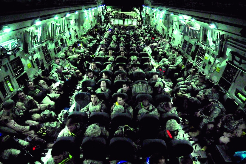Airmen of the 407th Air Expeditionary Group prepare to take-off on a  C-17 Globemaster III cargo aircraft at Ali Air Base, Iraq, Dec. 18, 2011. These  Airmen are the last service members to fly out of  Iraq.  The last remaining U.S. Airmen left Iraq per the Iraq and U.S. 2008 Security Agreement that required all U.S. service members to be out of the country by  Dec. 31. Since 2003, more than 1 million Airmen, Soldiers, Sailors and Marines have served in Iraq. (U.S. Air Force photo/Master Sgt. Cecilio Ricardo)