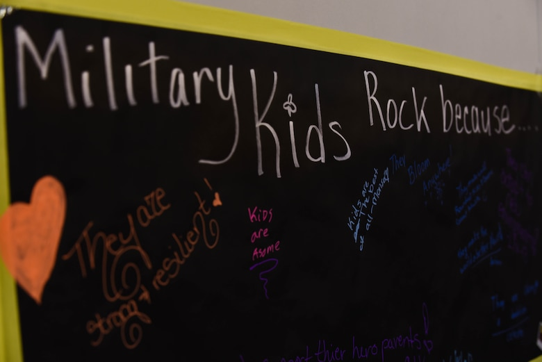 A poster hangs for military kids to write why they 'rock' during the Month of the Military Child Spring Bash April 27, 2018, on F.E. Warren Air Force Base, Wyo. There were various events and activities for the children to take part in, from corn hole to face painting. The 90th Force Support Squadron held this spring bash to celebrate the children of military members and what they experience.  (U.S. Air Force photo by Airman 1st Class Braydon Williams)
