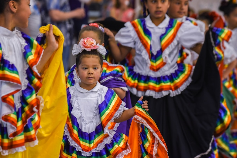 Dancers with Las Angelitas Unidas y Los Rayos del Sol youth dance group wait for their cue to begin dancing during the Month of the Military Child Spring Bash April 27, 2018, on F.E. Warren Air Force Base, Wyo. Las Angelitas Unidas y Los Rayos del Sol is a Mexican folkloric dance group with a mission to share culture through music and dance. The 90th Force Support Squadron held this spring bash to celebrate the children of military members and what they experience.  (U.S. Air Force photo by Airman 1st Class Braydon Williams)