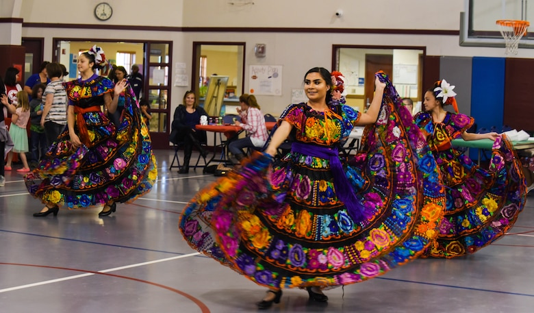 The youth dance group Las Angelitas Unidas y Los Rayos del Sol perform a dance routine during the Month of the Military Child Spring Bash April 27, 2018, on F.E. Warren Air Force Base, Wyo. Las Angelitas Unidas y Los Rayos del Sol is a nonprofit Mexican folkloric dance group dedicated to sharing culture through music and dance. The 90th Force Support Squadron held this spring bash to celebrate the children of military members and what they experience.  (U.S. Air Force photo by Airman 1st Class Braydon Williams)