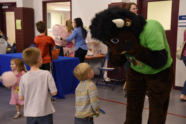 Children speak with Buddy Bison during the Month of the Military Child Spring Bash April 27, 2018, on F.E. Warren Air Force Base, Wyo. Buddy Bison is a program that allows children and families to participate in activities such as camping, canoeing, fishing, and hiking while exploring local state and national parks, with a goal to encourage children to be good stewards to the parks. The 90th Force Support Squadron held this spring bash to celebrate the children of military members and what they experience.  (U.S. Air Force photo by Airman 1st Class Braydon Williams)