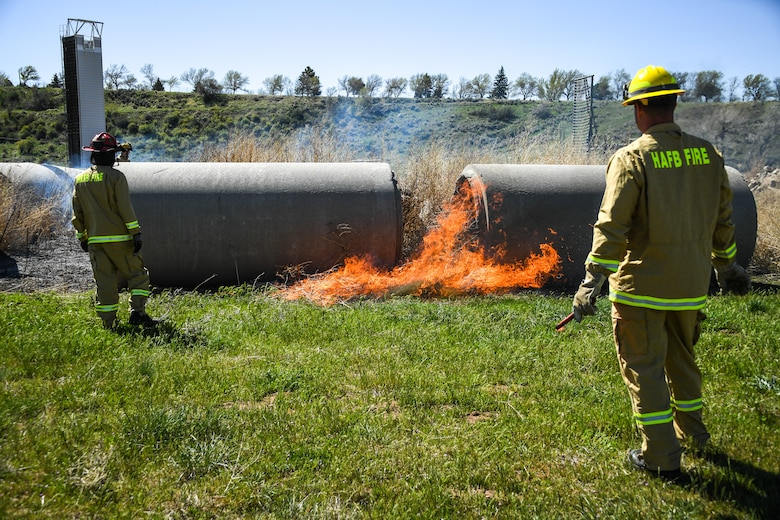 Firefighters conduct a controlled burn on a section of the Base Operations and Readiness Training Area April 27, 2018, at Hill Air Force Base, Utah. The prescribed burn targeted overgrown vegetation around structures used by the department's technical rescue program members and other partner emergency-services for training. (U.S. Air Force photo by R. Nial Bradshaw)