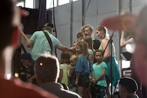 A photo of Gary Sinise, Lt. Dan Band electric bassist, interacts with children on stage during a performance, April 26, 2018, at Mountain Home Air Force Base, Idaho. Approximately 800 military members, veterans, family and friends attended the Lt. Dan Band concert. (U.S. Air Force Photo by Airman 1st Class Hailey Bivens)