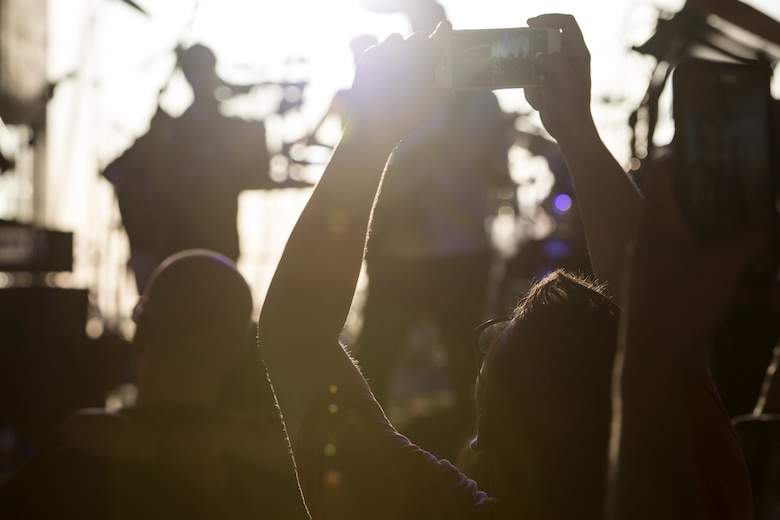A photo of a concert attendee takes a photo of the Lt. Dan Band, April 26, 2018, at Mountain Home Air Force Base, Idaho. The Lt. Dan Band is a function supported by the Gary Sinise Foundation. (U.S. Air Force Photo by Airman 1st Class JaNae Capuno)