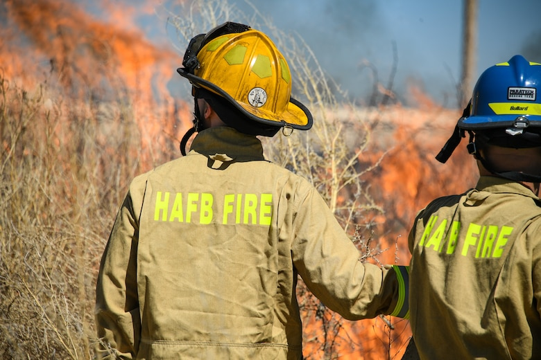 Firefighters conduct a controlled burn on a section of the Base Operations and Readiness Training Area April 27, 2018, at Hill Air Force Base, Utah. (U.S. Air Force photo by R. Nial Bradshaw)