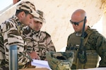 A fire support Marine with 4th Air Naval Gunfire Liaison Company, Force Headquarters Group, Marine Forces Reserve, discusses operations with members of the Moroccan armed forces.
