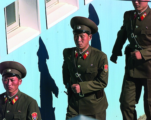 In 1998, People's Army guards from North Korea march in formation to their appointed posts during a repatriation ceremony in the Panmunjom Joint Security Area. (U.S. Air Force/James Mossman)