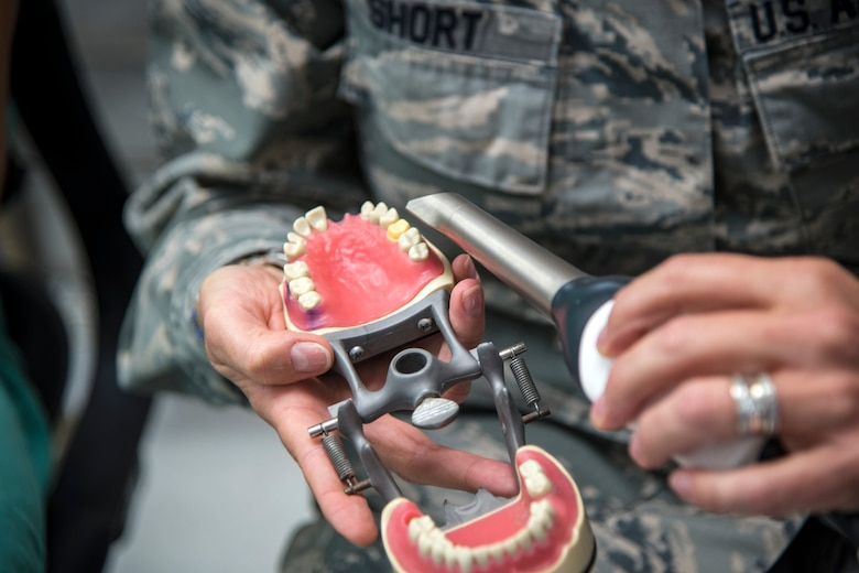 U.S. Air Force Col. Jennifer Short, 23d Wing commander, flashes a light on a jaw model at Moody Air Force Base, Ga., April 30, 2018. Short toured the 23d Medical Group (MDG) to gain a better understanding of their overall mission, capabilities, and comprehensive duties, and was able to experience the day-to-day operations of the various units within the 23d MDG, ranging from bioenvironmental to ambulatory care. (U.S. Air Force photo by Airman 1st Class Eugene Oliver)