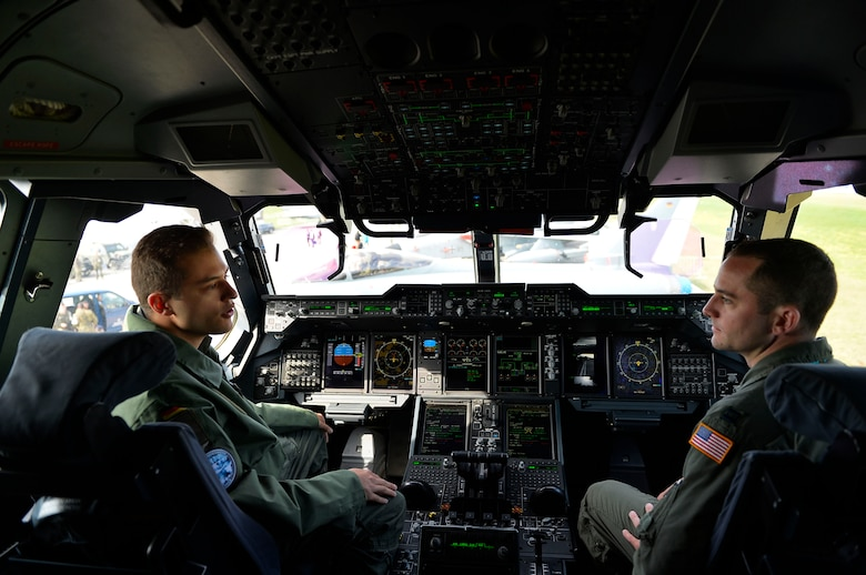 German Air Force 1st Lt. Felix, an A400M Atlas co-pilot, left, discusses the capabilities of his aircraft with U.S. Air Force Capt. Tim Vedra, 37th Airlift Squadron C-130J Super Hercules instructor pilot, in Berlin, Germany, April 27, 2018. U.S. and German Airmen shared knowledge with each other concerning their respective airframes during the 2018 Berlin Air and Trade Show. (U.S. Air Force photo by Senior Airman Joshua Magbanua)