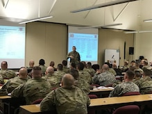 Lt. Col. Anthony Bianchi, 3-314th Field Artillery Battalion commander, briefs the attendees at the Northeast Regional Field Artillery Symposium on Joint Base McGuire-Dix-Lakehurst, New Jersey April 24, 2018. (U.S. Army photo by Sgt. 1st Class Corey Vandiver) (Photo Credit: Sgt. 1st Class Corey Vandiver)