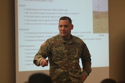 Lt. Col. Anthony Bianchi, 3-314th Field Artillery Battalion commander, briefs the attendees during the Northeast Regional Field Artillery Symposium on Joint Base McGuire-Dix-Lakehurst, New Jersey April 24, 2018. (U.S. Army photo by Sgt. 1st Class Corey Vandiver (Photo Credit: Sgt. 1st Class Corey Vandiver)