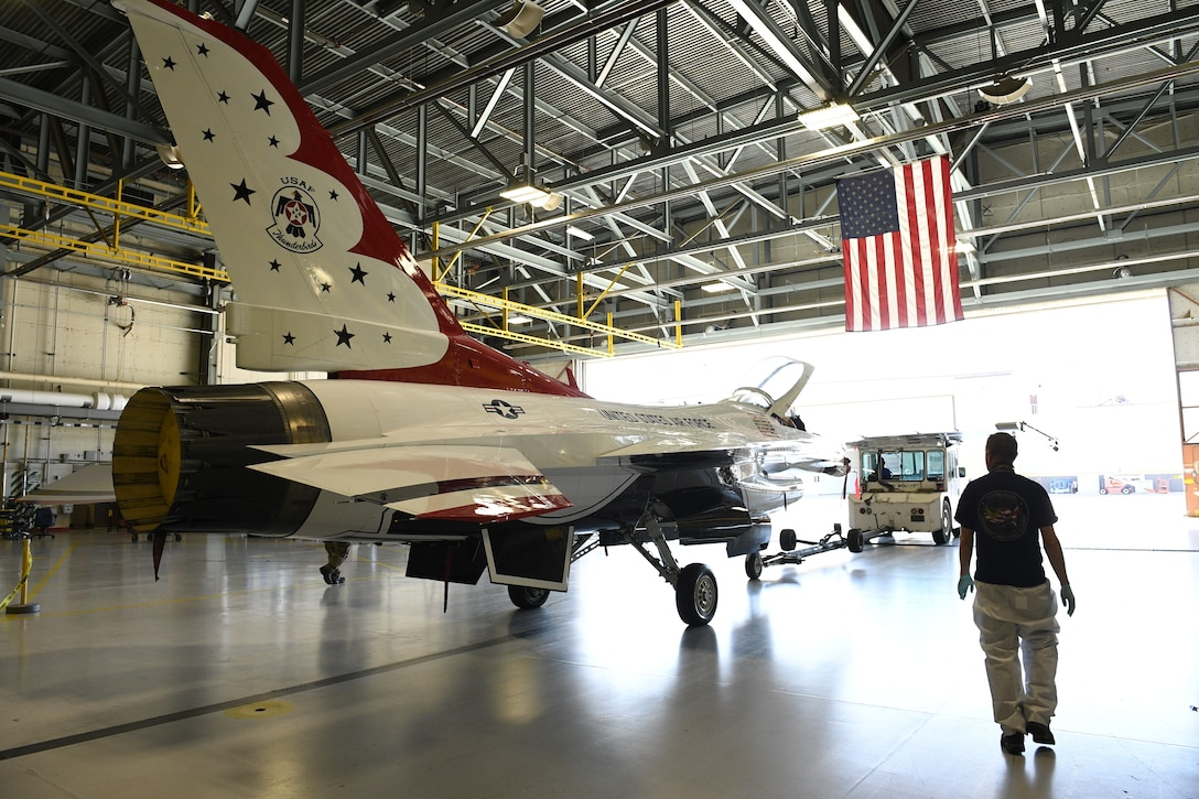 A U.S. Air Force Thunderbird F-16 jet is towed out of a hangar April 26, 2018 at Hill Air Force Base, Utah. The aircraft was the first to receive structural modifications as part of the F-16 Service Life Extension Program, or SLEP, that will keep the jet flying for decades. (U.S. Air Force photo by R. Nial Bradshaw)