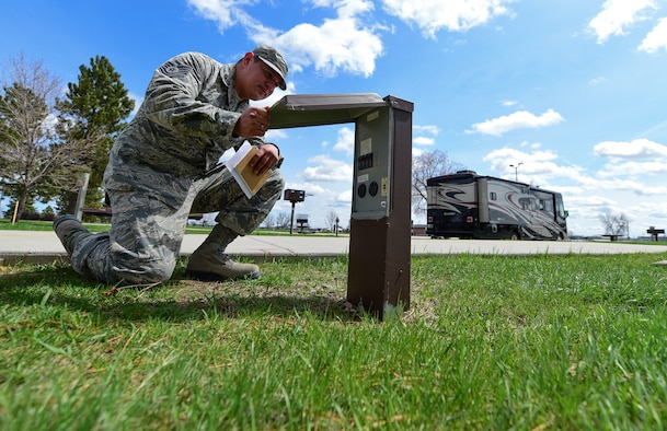Tech. Sgt. Kenneth Hill, 28th Bomb Wing safety assurance section chief, looks over an electrical outlet during an inspection in the family campground at Ellsworth Air Force Base, May 2, 2018. With warmer weather on the way, the 28th Bomb Wing Safety Office encourages individuals to keep safety a priority while enjoy the outdoors. (U.S. Air Force photo by Senior Airman Randahl J. Jenson)