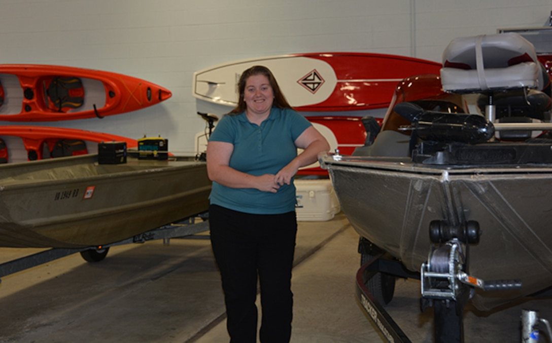 Cutshall poses in front of Outdoor Recreation watercraft