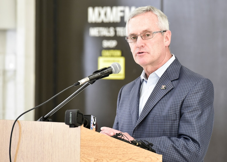 Youngstown State University President Jim Tressel gives remarks during a ceremony to unveil a new C-130H Hercules tail flash and nose art here, May 3, 2018.