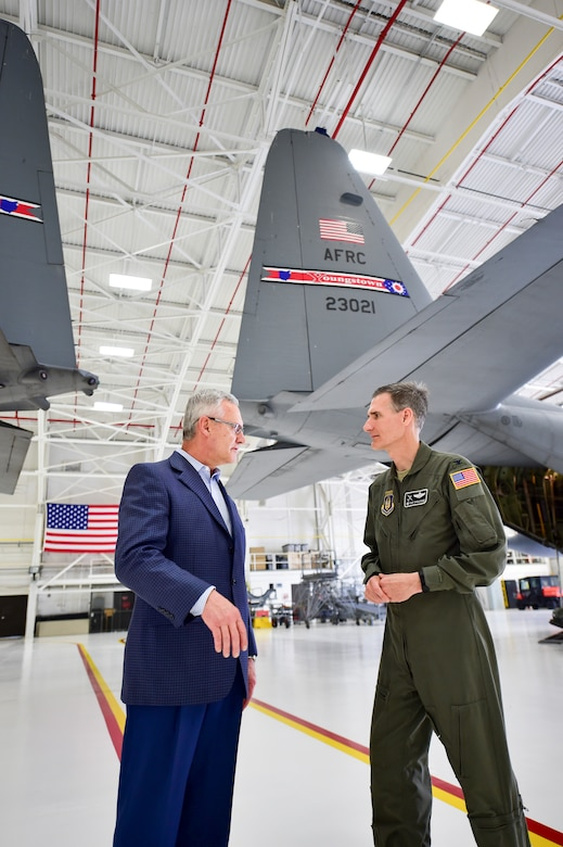 Youngstown State University President Jim Tressel and 910th Airlift Wing Commander Dan Sarachene talk near a pair of C-130H Hercules aircraft here, May 3, 2018, after a ceremony to unveil a new aircraft tail flash and nose art.
