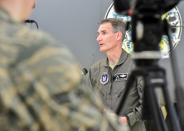 910th Airlift Wing Commander Col. Dan Sarachene talks with a local reporter May 3, 2018, after a ceremony to unveil a new aircraft tail flash and nose art.