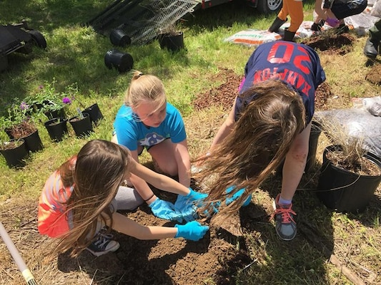 These Girl Scouts from Troop 390 plant native plants and grasses April 28, 2018 that will become an Ecological Landscape Exhibit for visitors to Cheatham Lake in Ashland City, Tenn. (USACE photo by Trey Church)