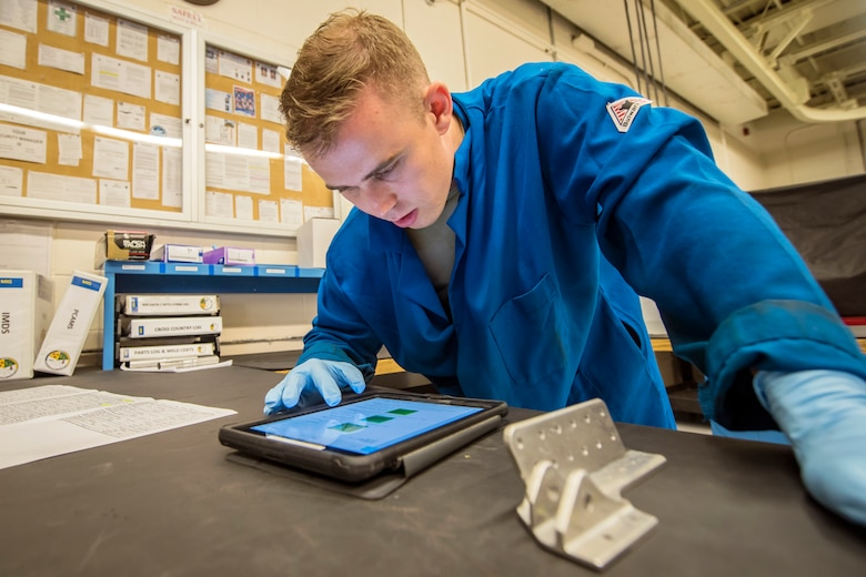 Senior Airman Matthew Horne, 23d Maintenance Squadron non-destructive inspection (NDI) specialist, reads a technical order, May 2, 2018, at Moody Air Force Base, Ga. NDI technicians use various methods to complete these inspections such as X-ray, florescent dye penetrant, oil analysis and ultrasonic scanning to examine and inspect numerous aircraft parts and components to ensure that they are in usable condition. (U.S. Air Force photo by Airman 1st Class Eugene Oliver)