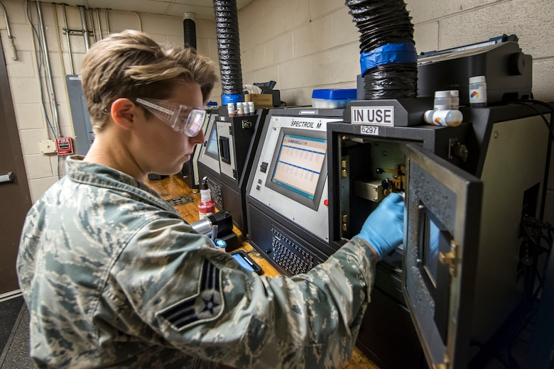 Senior Airman Louisa Doyle, 23d Maintenance Squadron non-destructive inspection (NDI) specialist, places an oil sample inside of a joint oil analysis program machine, May 2, 2018, at Moody Air Force Base, Ga. NDI technicians use various methods to complete these inspections such as X-ray, florescent dye penetrant, oil analysis and ultrasonic scanning to examine and inspect numerous aircraft parts and components to ensure that they are in usable condition. (U.S. Air Force photo by Airman 1st Class Eugene Oliver)