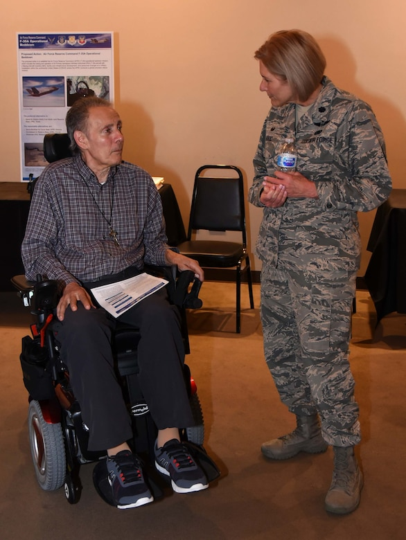 Lt. Col. Trina Hood, 301st Fighter Wing Mission Support Group Commander, at Naval Air Station Fort Worth Joint Reserve Base, Texas, meets with a local resident at the F-35A Environmental Impact Statement (EIS) Public Scoping Meeting April 19, 2018 in Fort Worth, Texas. The meeting solicited comments from the community about the F-35A aircraft bed down that would replace the current F-16 mission. The community can still give comments at http://www.afrc-f35a-beddown.com until May 11, 2018. (U.S. Air Force photo by Tech. Sgt. Charles Taylor)