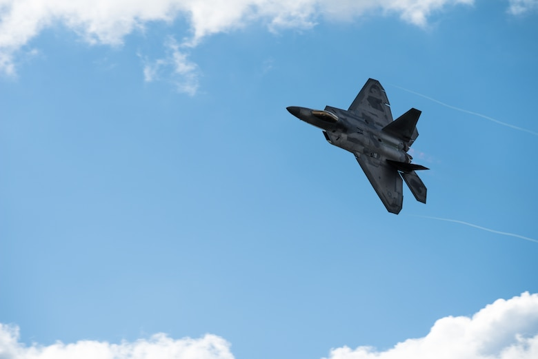 An F-22 Raptor banks during its performance at the Air and Space Expo hosted by Beale Air Force Base, California, April 27, 2018. The F-22 is the Department of Defense's fifth generation fighter air craft adopted by the Air Force in 2005. (U.S Air Force photo/Senior Airman Justin Parsons)