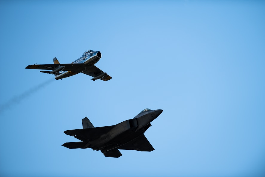 A F-86 Sabre and F-22 Raptor fly in formation during a heritage flight at the Air and Space Expo at Beale Air Force, California, April 27, 2018. The F-86 was the first swept wing fighter aircraft in the Department of Defense and was officially operated by the Air Force in 1949.(U.S Air Force photo/Senior Airman Justin Parsons)