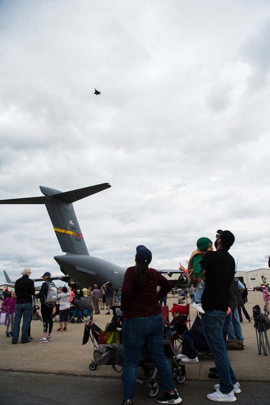 Visitors watch the F-22 Raptor demonstration during the Air and Space Expo April 28, 2018, at Beale Air Force Base, Calif. This was beale's first airshow since 2011. (U.S. Air Force photo/ Senior Aimran Justin Parsons)