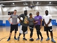 Master Sgt. Dawn Williams, 932nd Health Professions Recruiter, in purple shirt, gathers part of her team during a break in the volleyball action on April 26, 2018, at Scott Air Force Base, Ill.  The teams usually play competitive games on Tuesdays and Thursdays against other government agencies on base.  Williams recruits new medically-trained civilians into the Air Force Reserve by day, and also coaches the 932nd Airlift Wing's volunteer volleyball team by night.  Those interested in either joining the 932nd Airlift Wing as new Airmen, or those already in the wing looking to join the volleyball action can contact her at 618-229-7077.  (U.S. Air Force photo by Lt. Col. Stan Paregien)