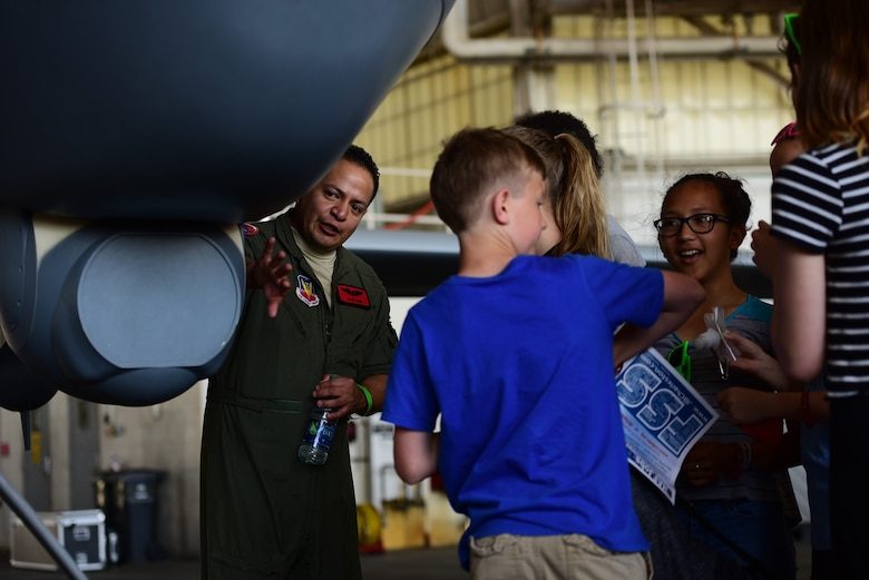 Tech. Sgt. Daniel, 489th Attack Squadron sensor operator, explains the capabilities of the Multi-Spectral Targeting System of an MQ-9 Reaper to spectators April 27, 2018, at the Joint Base Charleston Air & Space Expo at JB Charleston, S.C. More than 80,000 spectators were able to learn about the MQ-9 and how the Airmen who fly and maintain it deliver persistent attack and reconnaissance capabilities. (U.S. Air Force photo by Senior Airman Christian Clausen)