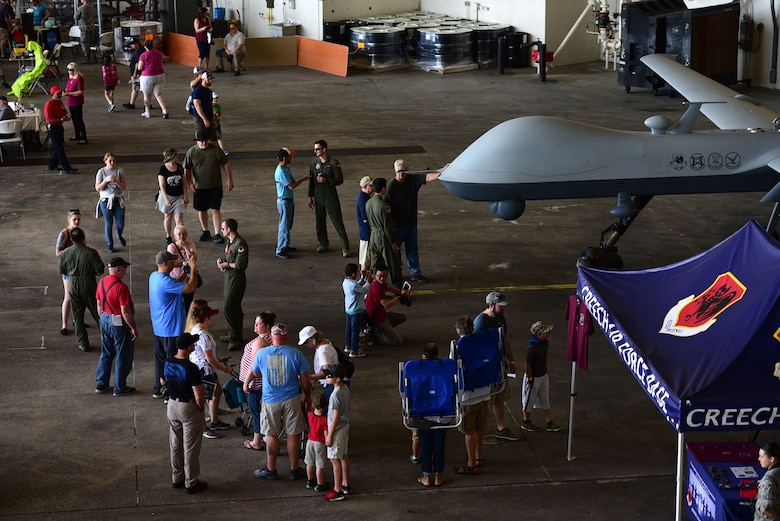 Spectators get an up-close and personal look at the MQ-9 Reaper April 28, 2018, during the Joint Base Charleston Air & Space Expo at JB Charleston, S.C. During the air show more than 80,000 spectators had the opportunity to learn about the MQ-9 and its mission from the Airmen who fly, maintain and support it. (U.S. Air Force photo by Senior Airman Christian Clausen)