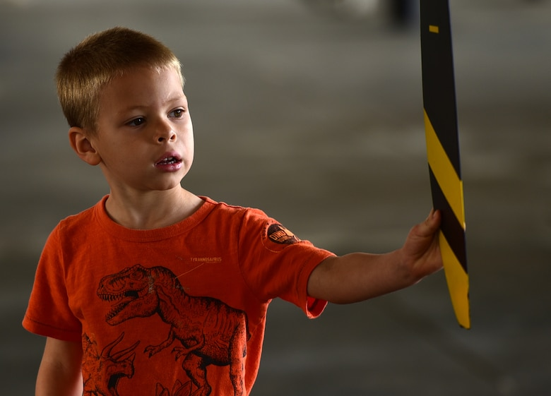 Damian Kemp, five, son of Tech. Sgt. Roger Kemp, 628th Civil Engineering Squadron fire fighter, inspects the propeller of an MQ-9 Reaper April 27, 2018, at the Joint Base Charleston Air & Space Expo at JB Charleston, S.C. During the event, spectators received an up-close and personal look at the Reaper and interacted with the crews who fly, maintain and support the aircraft and its mission. (U.S. Air Force photo by Senior Airman Christian Clausen)