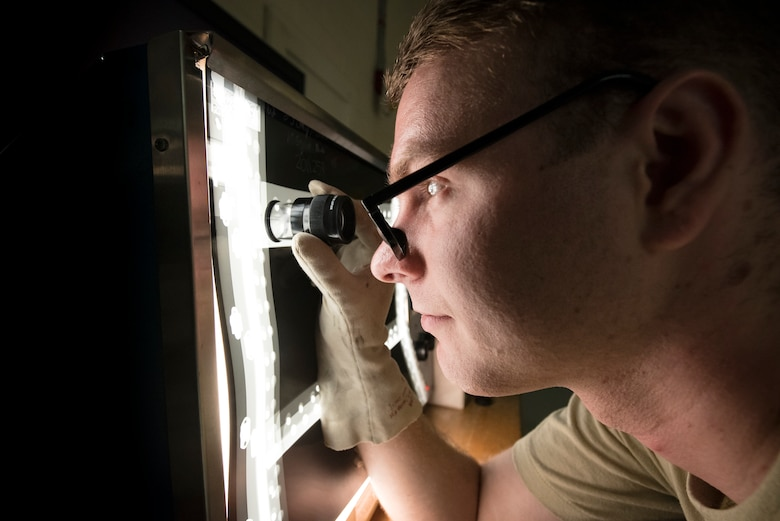 U.S. Air Force Senior Airman Austin Aldridge, 23d Maintenance Squadron non-destructive inspection (NDI) specialist, inspects an aircraft part through an X-ray at Moody Air Force Base, Ga., May 2, 2018. NDI technicians use various methods to complete these inspections, such as X-ray, florescent dye penetrant, oil analysis, and ultrasonic scanning to examine and inspect numerous aircraft parts and components to ensure they are in usable condition. (U.S. Air Force photo by Airman 1st Class Eugene Oliver)