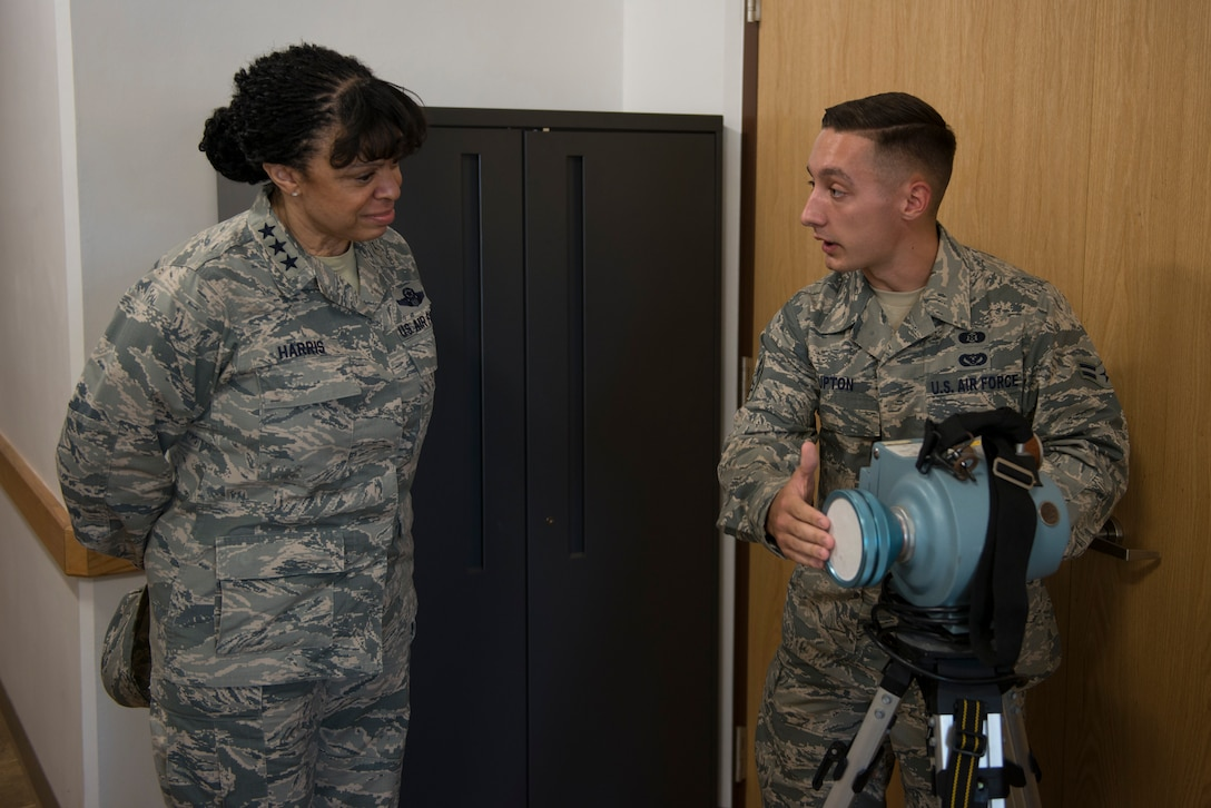Lt. Gen. Stayce D. Harris, the U.S. Air Force inspector general, is introduced to radiological detection equipment by Airman 1st Class Brennan Upton, assigned to the 36th Civil Engineer Squadron, during a brief on 36th Wing emergency management operations on Andersen Air Force Base, Guam, 3 May, 2018. General Harris visited Andersen during a tour of the Pacific Region. At Andersen General Harris visited the IG team, Air Force Office of Special Investigations agents and emergency management teams. (U.S. Air Force photo by Senior Airman Zachary Bumpus)
