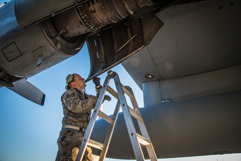 Staff Sgt. Spencer Magers inspects the intake and exhaust on the engines of a C-130H Hercules that sits on the flightline while awaiting the mission for the day at the 179th Airlift Wing, Mansfield, Ohio, April 26, 2018. (U.S. Air National Guard photo by Capt. Paul Stennett)