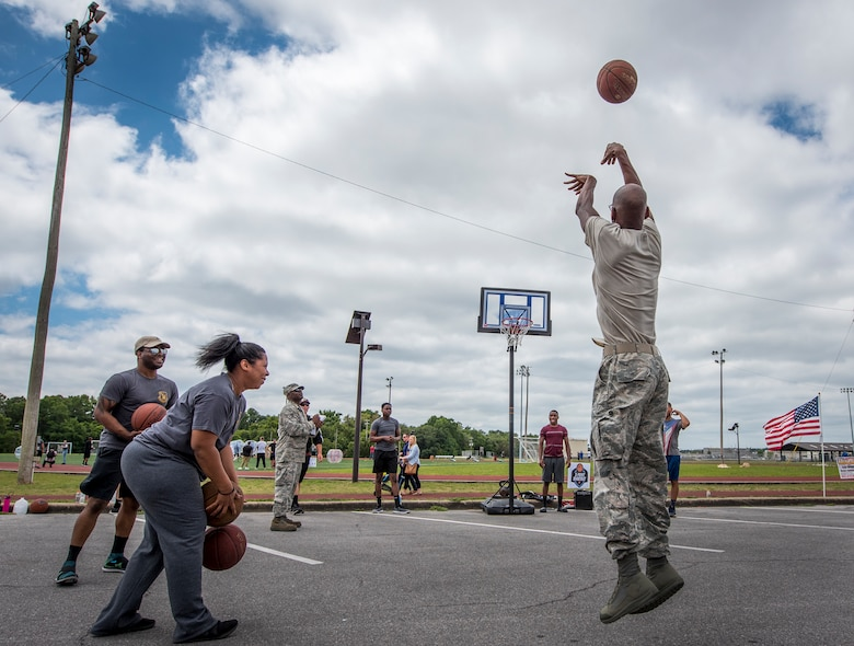 An Airman releases his three-point shot as part of the Eglin Connects event at Eglin Air Force Base, Fla., April 27, 2018. The event, to help promote resiliency, featured information booths, sporting events and a car show. (U.S. Air Force photo by Samuel King Jr.)